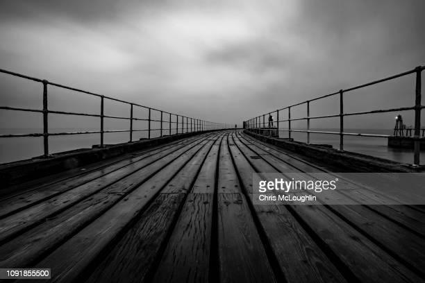 whitby pier, north yorkshire - northern rail stock pictures, royalty-free photos & images
