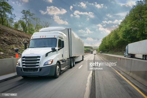 white 18 wheeler commercial truck new on the highway - autonomous technology stock pictures, royalty-free photos & images