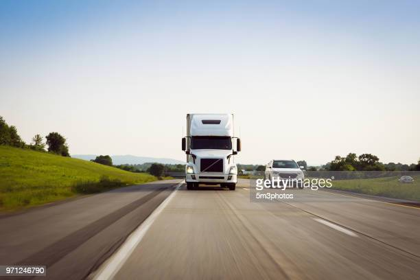 white 18 wheeler semi-truck driving on highway - major road stock pictures, royalty-free photos & images