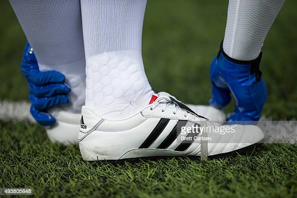 White Adidas soccer cleats worn by a kicker for the Buffalo Bills before the game against the New York Giants on October 4 2015 at Ralph Wilson...