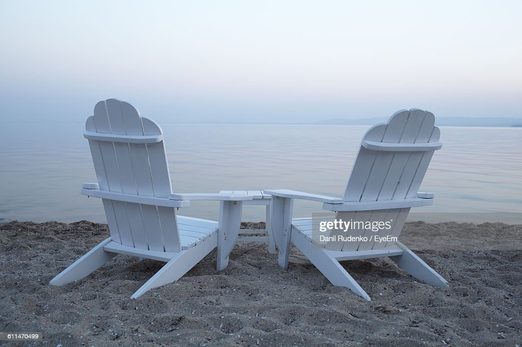 adirondack chairs on beach sunset. Exellent Chairs White Adirondack Chairs On Sand At Beach Against Sky During Sunset  Stock  Photo With C