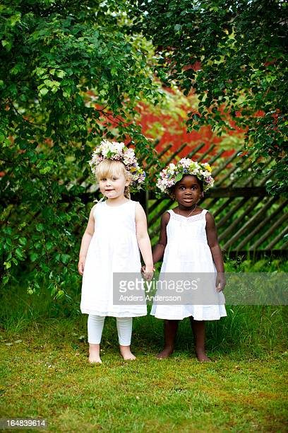 White and black children holding hands
