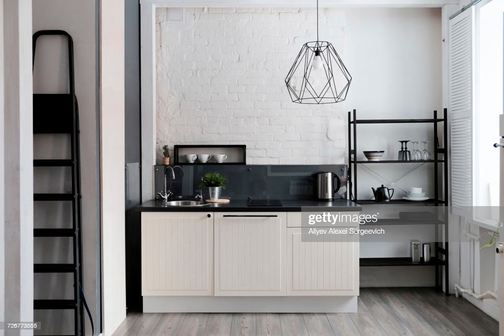 White and black domestic kitchen : Stock Photo