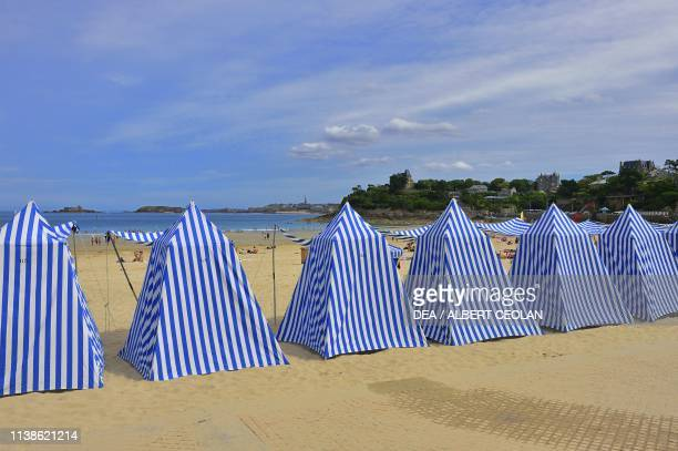 White and blue-striped tents on Ecluse beach, Dinard, Ille-et-Vilaine, Brittany, France.