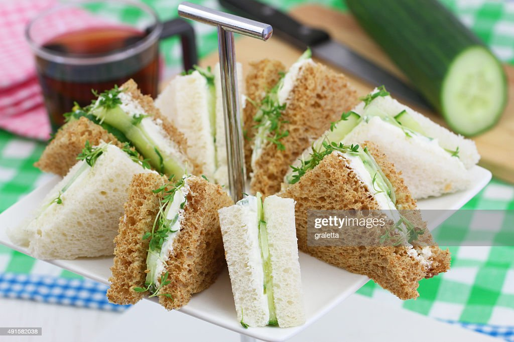 White and brown cream cheese and cucumber sandwiches : Stock Photo