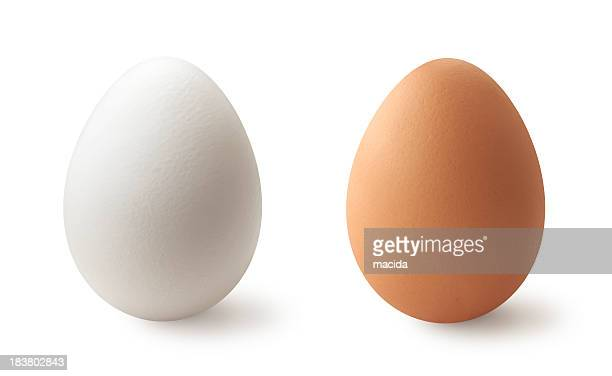 white and brown eggs - oval shaped objects stock pictures, royalty-free photos & images