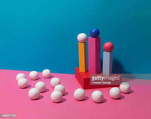 White and Coloured Balls on Coloured Plinths