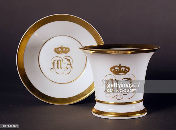 White and gold cup and saucer bearing the initials of the Grand Duchess Maria Antonia of Tuscany 18331840 porcelain Ginori manufacture Doccia Sesto...