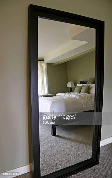 white and green bedroom reflected in a mirror - full length mirror stock photos and pictures