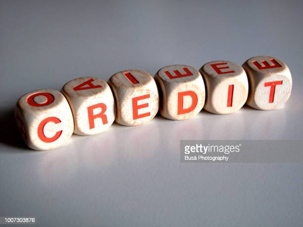 """White and orange scrabble dice spelling the word """"CREDIT"""""""