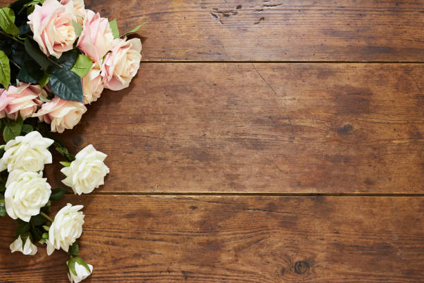 White And Pink Roses On Rustic Wood Background