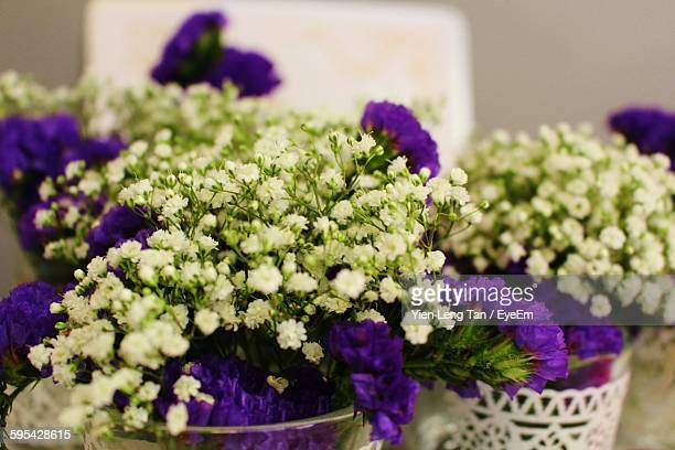 White And Purple Flower Bouquet At Wedding