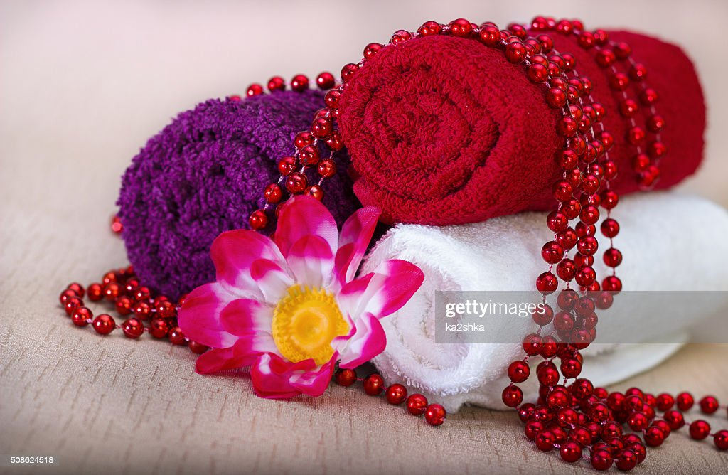 White and red towel around beads and flowers : Stock Photo