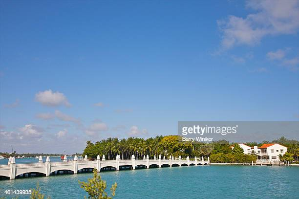 White arched bridge leading to green island
