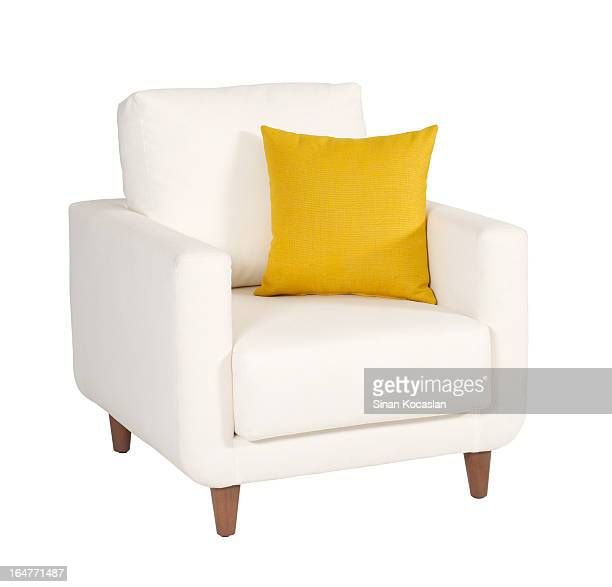 White armchair with small yellow pillow