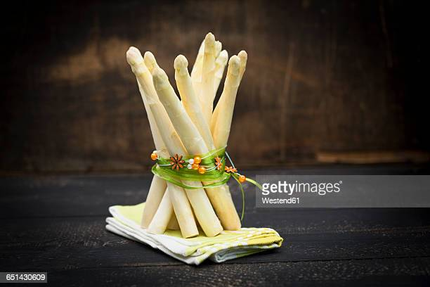 White asparagus, bunch on wood