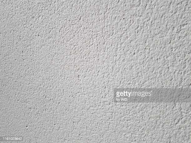 a white background of textured plaster wall - cream colored stock pictures, royalty-free photos & images