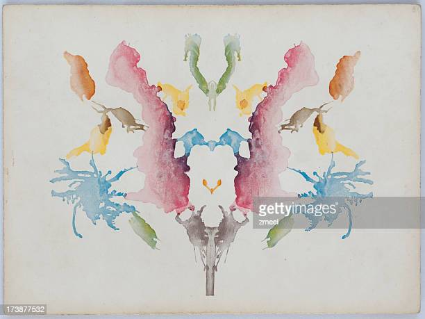 a white background with colorful ink blots - pareidolia stock pictures, royalty-free photos & images