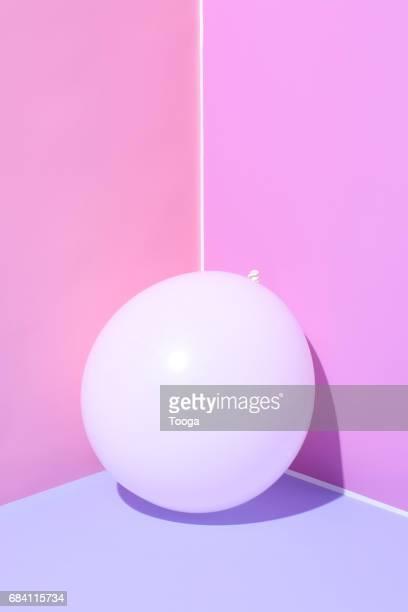 White balloon in a corner