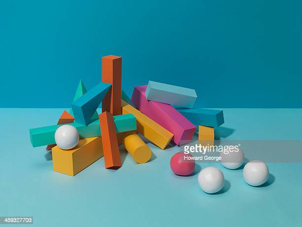 White Balls and Coloured Shapes
