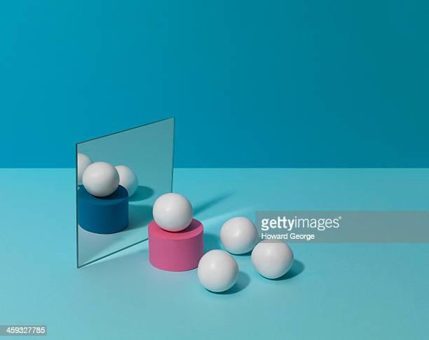 White Balls on Coloured Plinths