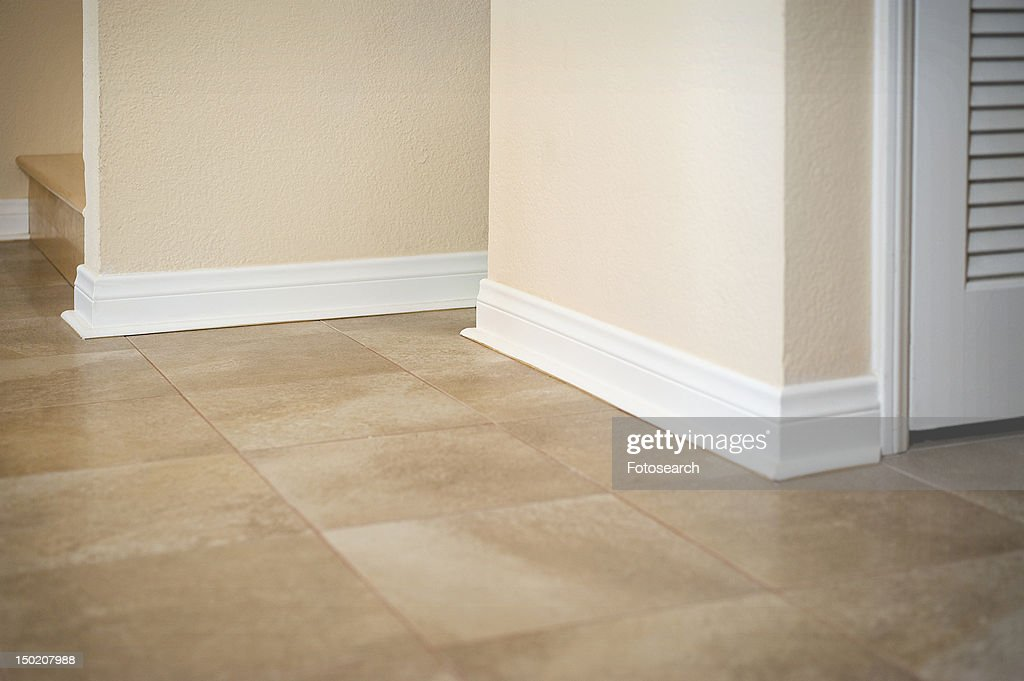White Baseboard Along Ceramic Tile Floor Stock Photo Getty Images