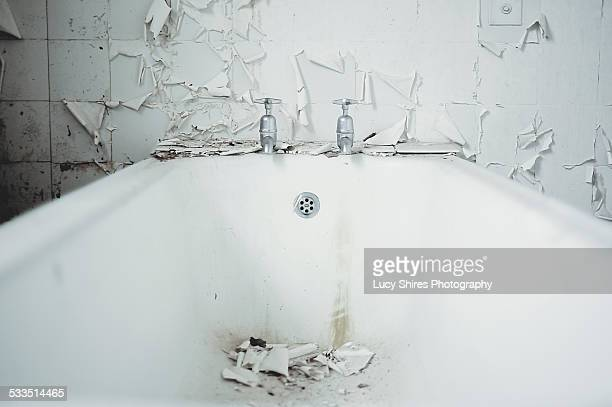white bath with white peeling paint and tiles - lucy shires stock pictures, royalty-free photos & images
