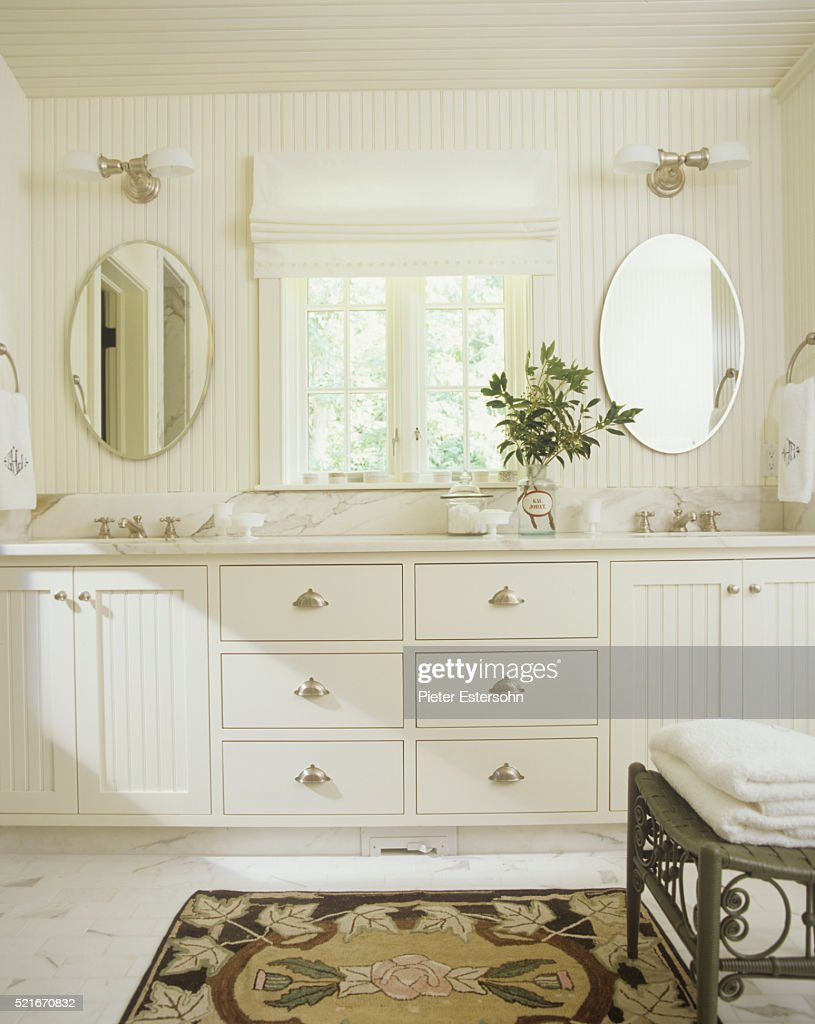 White Bathroom With Beaded Paneling Stock Photo | Getty Images