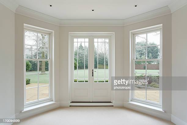 white bay windows and french doors - deur stockfoto's en -beelden