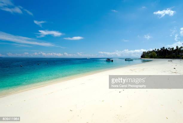 white beach and crystal clear waters in sibuan island - island of borneo stock pictures, royalty-free photos & images