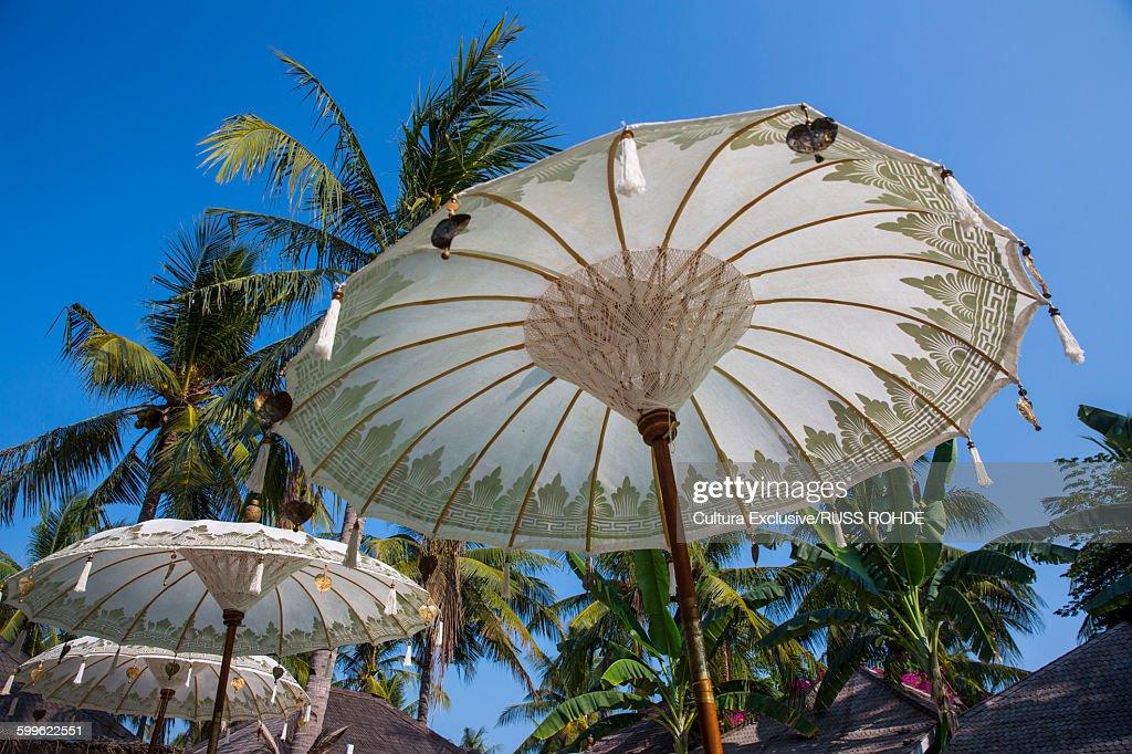 White Beach Umbrellas And Palm Trees Gili Traan Lombok Indonesia Stock Photo