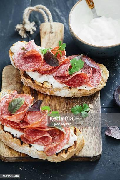 White bean, horseradish and salami bruschetta