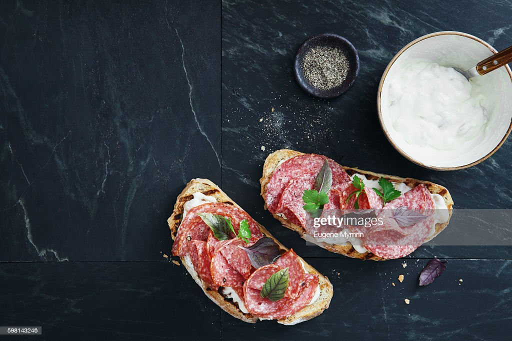 White bean, horseradish and salami bruschetta : Stock Photo