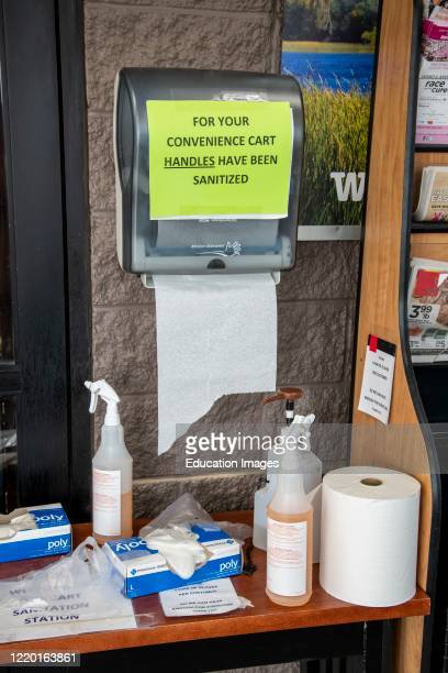 White Bear Lake, Minnesota, Sanitizers and protective equipment at the entrance of a grocery store to protect the customers from the coronavirus.
