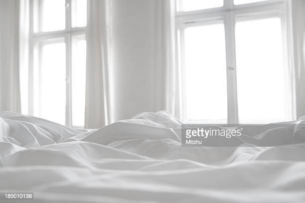 white bed linen - linen stock photos and pictures