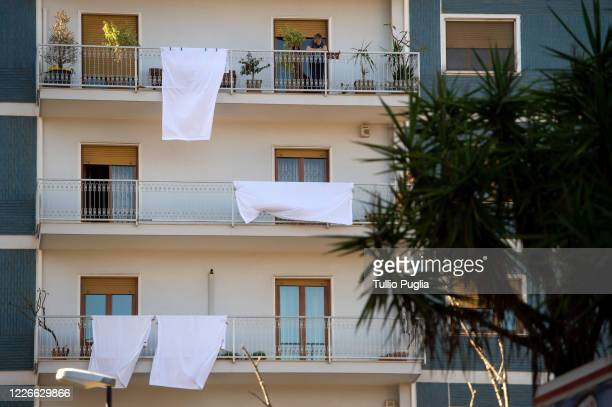 White bed sheets are displayed outside balcony to commemorate the 28th anniversary of the Capaci Massacre on May 23, 2020 in Palermo, Italy. On May...