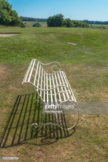 white beech seat at the field - ammunition magazine stock photos and pictures