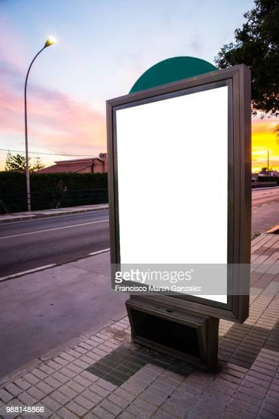 white billboard in a street