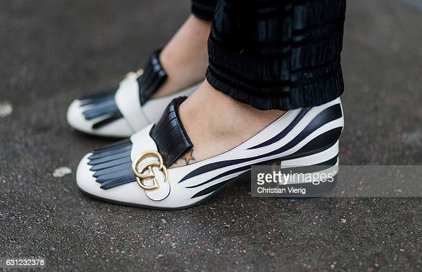 White black zebra Gucci shoes Marmont fringed zebraapplique leather loafers during London Fashion Week Men's January 2017 collections at on January 8...
