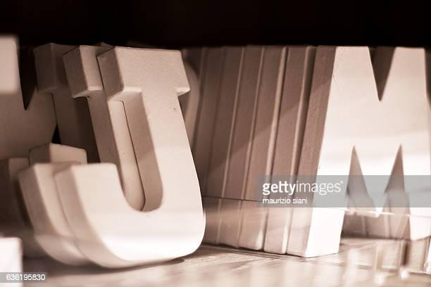 White block letters spelling JM