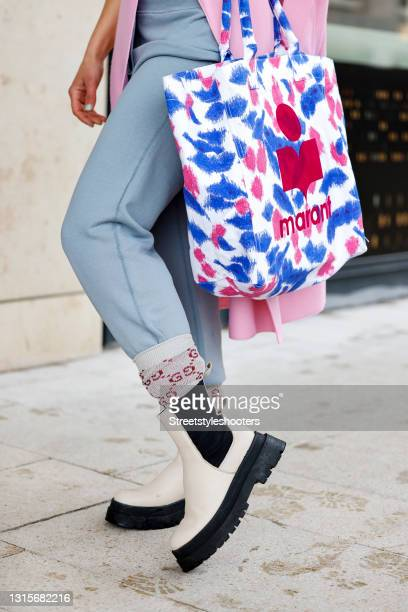 White, blue and pink bag by Isabel Marant, beige socks by Gucci and beige and black boots by LeGer by Lena Gercke as a detail of german singer Jasmin...