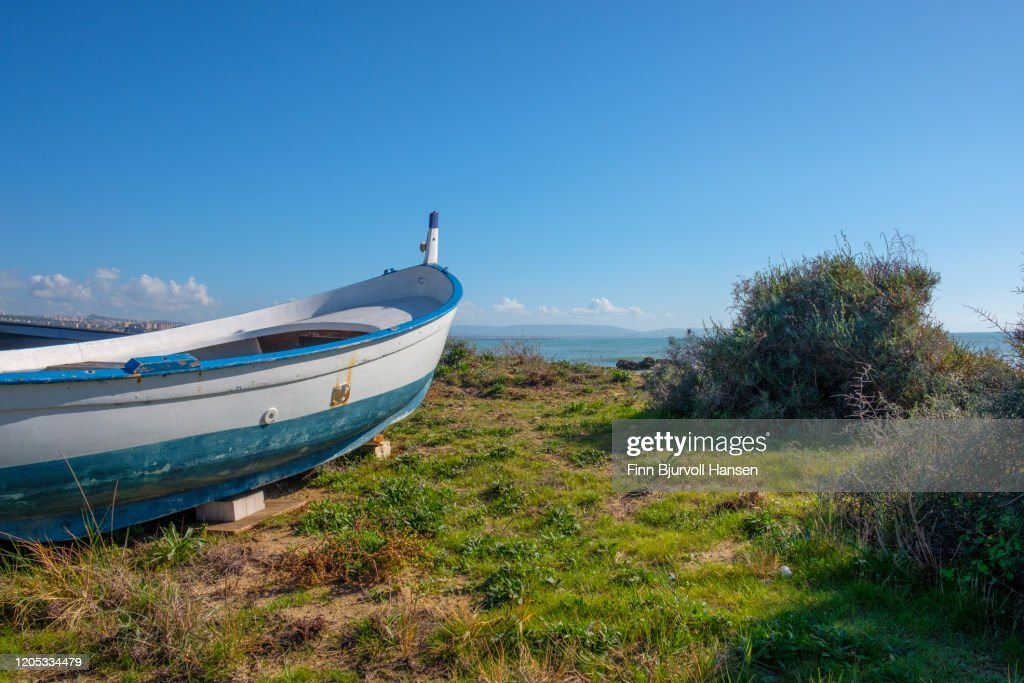 White boat standing on land : Stock Photo