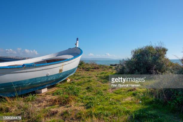 white boat standing on land - finn bjurvoll stock pictures, royalty-free photos & images