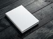 White book Mockup on dark wooden table background