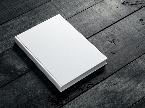 White book Mockup on dark wooden table background 1062814664
