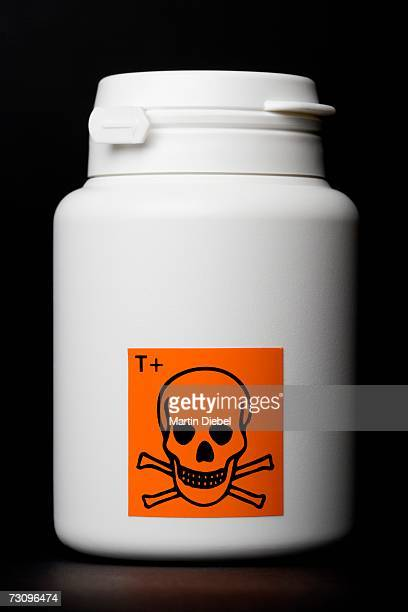 white bottle with toxic warning label - danger stock photos and pictures