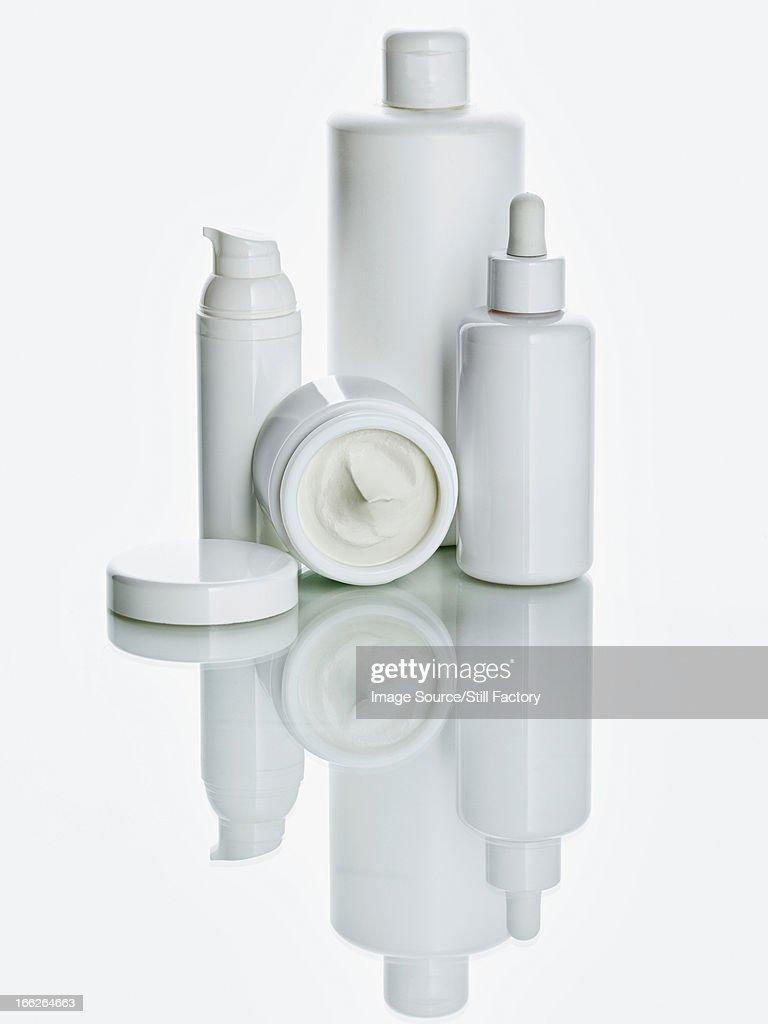 White bottles on counter : Stock Photo