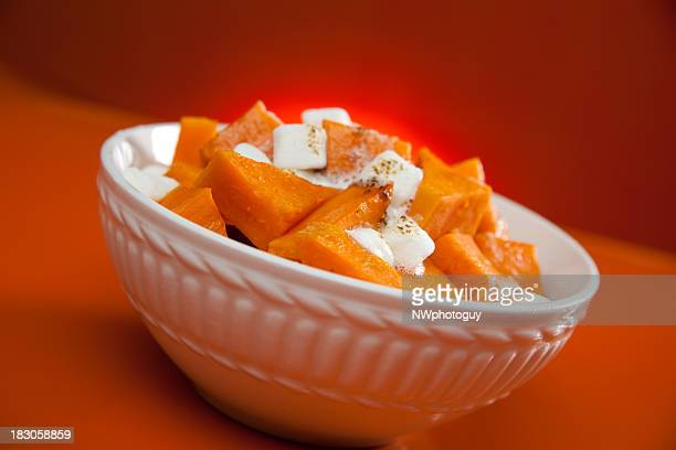 White bowl with cooked yams and marshmallows