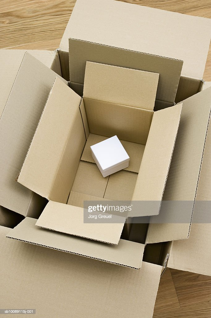 White box in cardboard boxes, high angle view, close-up : Stockfoto
