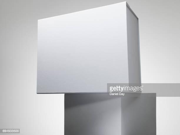 White box on a white plinth